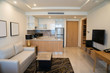 Leinwanddruck Bild - Modern interior design of studio apartment. Hotel room with living space and kitchen corner counter with appliances. Apartment concept
