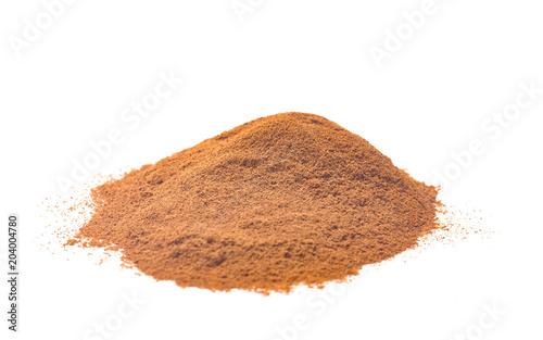 Fototapeta Ground Cinnamon on a White Background obraz