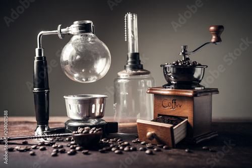 Japanese siphon coffee maker and coffee grinder on old kitchen table Canvas Print