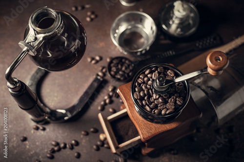 Photo  Japanese siphon coffee maker and coffee grinder on old kitchen table