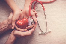Child And Adult Holding Red Heart With Stethoscope, Heart Health,  Health Insurance Concept, World Heart Day, World Health Day, World Hypertension Day, Health Insurance
