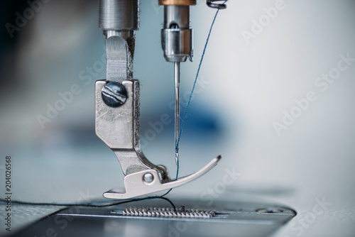 Fotografie, Obraz  close-up shot of needle and thread of sewing machine