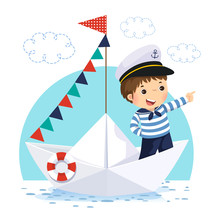 Little Boy In Sailor Costume Standing In A Paper Boat