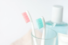 Toothbrushes, Toothpaste, Rinse And Towel On White Background. Dental And Healthcare Concept. Free Copy Space.