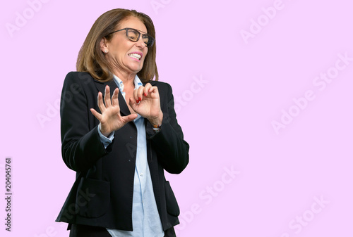 Fotografie, Tablou  Middle age business woman disgusted and angry, keeping hands in stop gesture, as