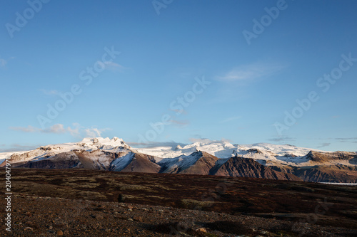 Volcanic landscape with mountains near glacier, South Iceland
