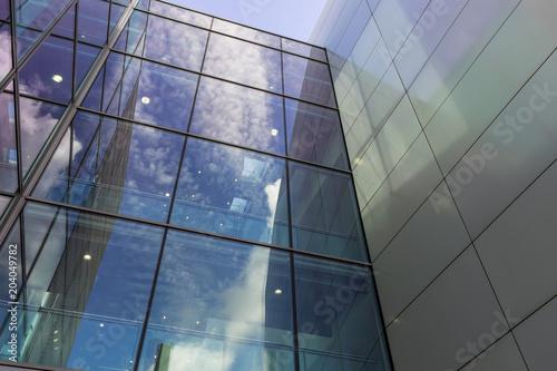 Fotografija  The glass architecture in city against a sky