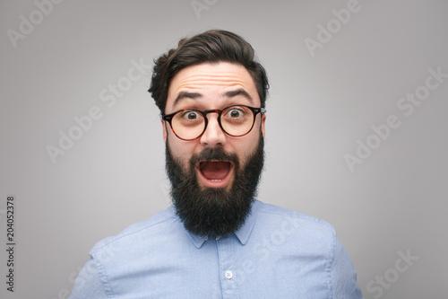 Fotografie, Obraz  Shocked bearded man in glasses