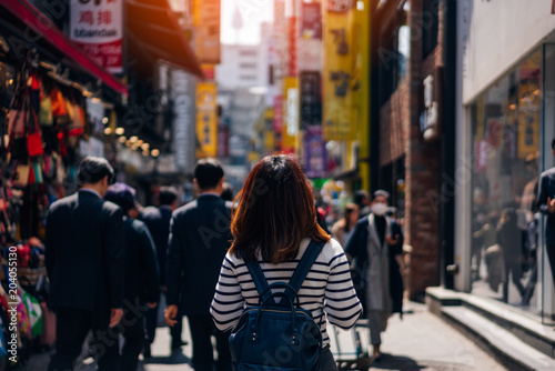 Poster de jardin Seoul Young asian woman traveler traveling and shopping in Myeongdong street market at Seoul, South Korea. Myeong Dong district is the most popular shopping market at Seoul city.