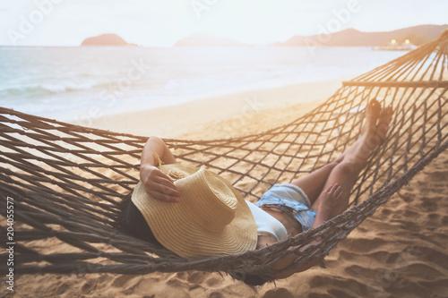 Fotografía Happy woman relaxing in hammock