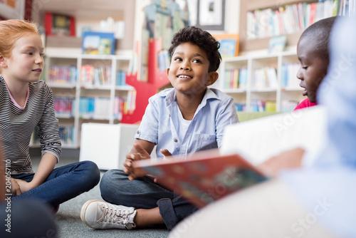 Fotografie, Obraz  Children listening stories