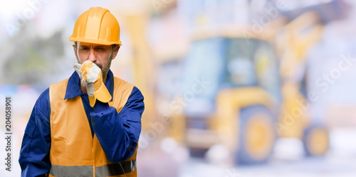 Fotografie, Obraz  Senior engineer man, construction worker sick and coughing, suffering asthma or