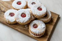Jam Filled Round Linzer Cookies With Powder Sugar