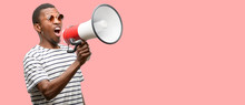 African Black Man Wearing Sunglasses Communicates Shouting Loud Holding A Megaphone, Expressing Success And Positive Concept, Idea For Marketing Or Sales