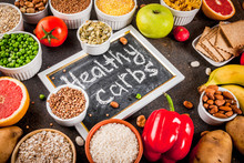 Diet Food Background Concept, Healthy Carbohydrates (carbs) Products - Fruits, Vegetables, Cereals, Nuts, Beans, Dark Blue Concrete Background