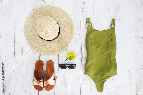 Valokuva  Beach accessories on white wooden background
