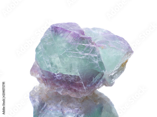 macro shooting of natural mineral rock specimen - fluorite stone on an isolated white background,reflection