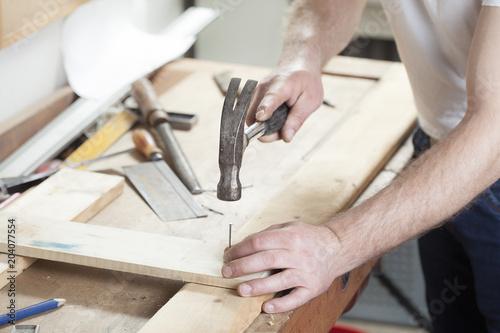Fotografie, Obraz carpeter hammering nail.copy space