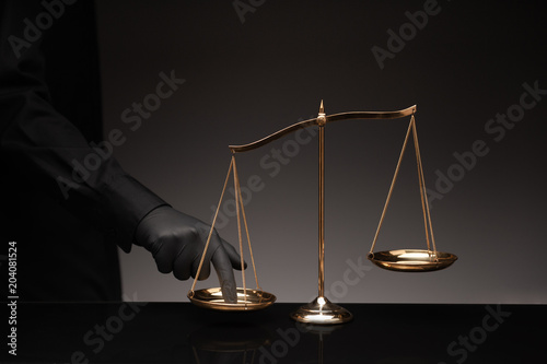 Man pressing on balance scale Fototapet