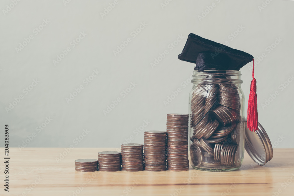 Fototapety, obrazy: Scholarship money concept. Coins in jar with money stack step growing growth saving money investment