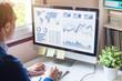 Businessman analyzing Business Analytics dashboard with KPI, financial metrics, fintech