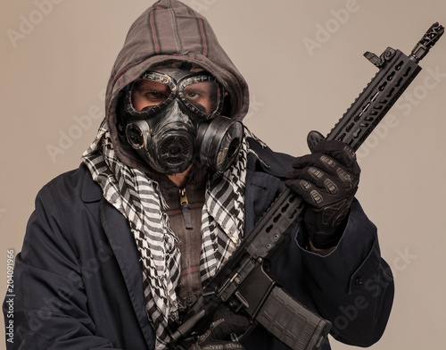 Fotografie, Obraz  Doomsday man with rifle, hood and gas mask.
