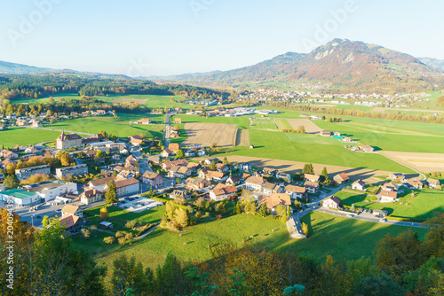Spoed Foto op Canvas Wijngaard Aerial view of a beautiful landscape with traditional houses, green meadows, Gruyeres, Switzerland