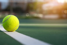 Close Up Tennis Ball On Court Background With Copy Space