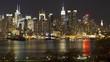 Beautiful evening light illumination night time lapse panorama view on Manhattan downtown architecture cityscape skyline