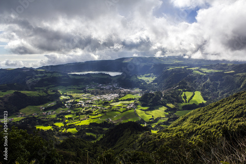 Foto op Canvas Donkergrijs Stunning Landscape with farm fields, green hills, village and a lagoon. Azores landscape aerial view