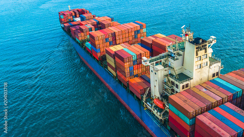 Fotografía  Aerial top view container cargo ship, Business logistic and transportation of International by ship in the open sea