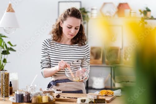 Fototapeta Vegan woman mixing natural ingredients obraz