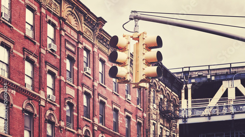 Tuinposter New York City Retro toned picture of New York City traffic lights, selective focus, USA.