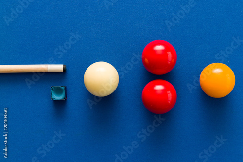 Balls and a cue seen on the table of a Carom Billiard Fotobehang