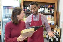 Salesman Giving Woman Advice O...