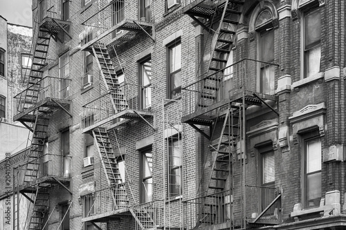 Foto op Aluminium New York City Black and white picture of fire escapes, one of the New York City symbols, USA.