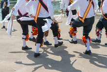 Morris Men Wearing Bells And White Shirts And Stockings Dance On May Day Bank Holiday With Sticks And Handkerchiefs