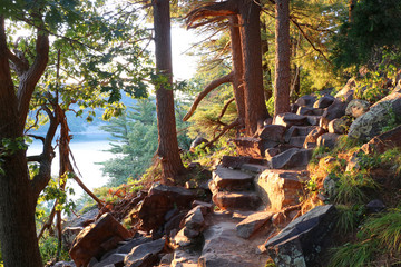 FototapetaBeautiful Wisconsin summer nature background. Ice age hiking trail and stone stairs in sunlight during sunset hours. Devil'•s Lake State Park, Baraboo area, Wisconsin, Midwest USA.