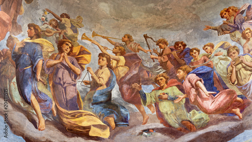Fotografering REGGIO EMILIA, ITALY - APRIL 12, 2018: The Fresco of angels with the music instruments in cupola of church Basilica di San Prospero by  C