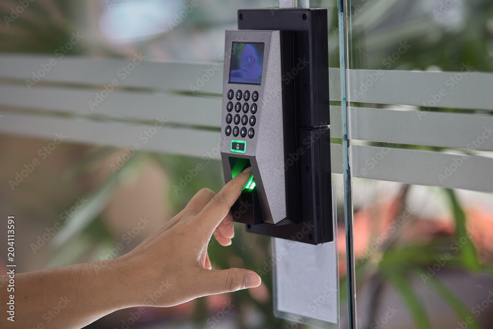 Fototapeta Close up hand of Yong man push finger down on the electronic control machine to access the door