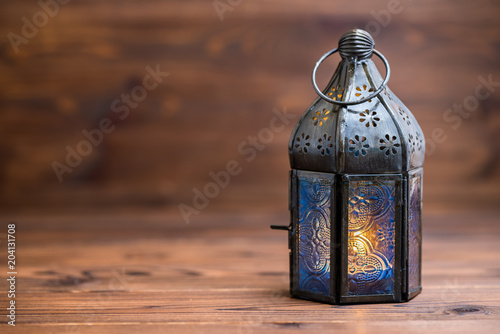 Arab lamp on wooden background, concept Ramadan Kareem