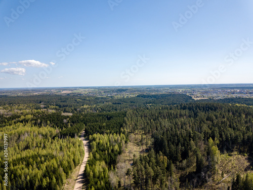 Foto op Canvas Blauwe hemel drone image. aerial view of rural area with fields and forests and gravel roads seen from above