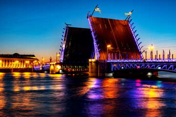 Fototapeta na wymiar The Opening of The Palace Bridge over the River Neva in St Petersburg, Russia at night