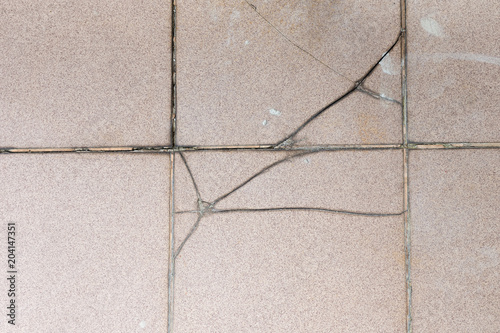 Cracked Ceramic Tiles And Fugue Outer Terrace Floor Surface Due To