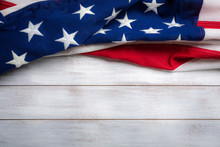 United States Flag On White, Weathered Clapboard Background With Copy Space