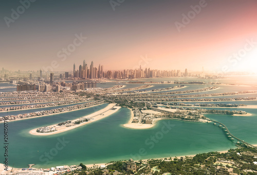 Photo  Dubai skyline from Palm Island at sunset
