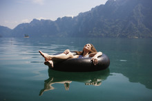 Woman Relaxing On A Floating R...