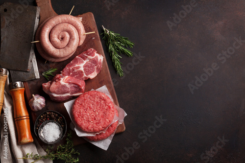 Fototapeta Raw meat and sausages obraz