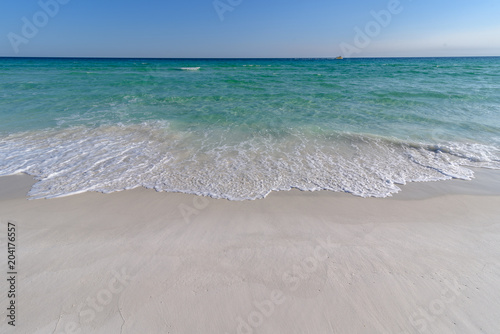 Canvas Print Gulf of Mexico emerald green and blue water washing on shore in waves