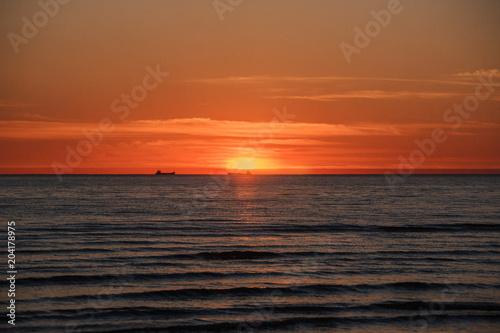 Deurstickers Zee zonsondergang Vintage look sunset scene on Baltic sea at Latvia coast.